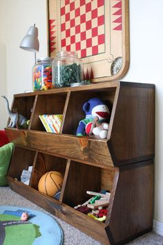 Cubby Storage Shelves | Plans, $10. Looks great, best for older kids who won't pull the shelves down on themselves. I'd probably go with a cherry wood. If energetic, maybe put an added design on the sides.