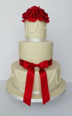 Found on WeddingMeYou.com - Lucky Red Asian Wedding Cakes - White Christmas #weddingcake - If you are lucky enough to have a white Christmas wedding, your color scheme can be quite simple. One big burst of red set against all that white, and you're good to go :)