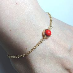 Red cinnabar gold plated by BeadsLearnToRock on Etsy