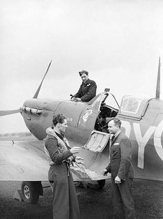 Apr 8,1942: A Czech Spitfire pilot of No 313 Squadron in conversation with his rigger and fitter at Hornchurch.