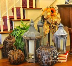 At the bottom of my stairs are my lanterns. I used wicker pumpkins around them. The large bow on the lantern is decorated with more Fall foliage and flowers.