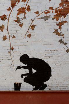 Artist Pejac incorporates vines on a wall into his piece #graffiti #streetart
