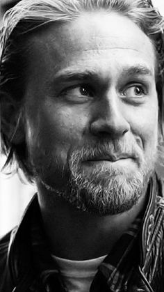Charlie Hunnam biting his lip OMG I'm dying..... Can't breathe wayyyyy to adorable to live