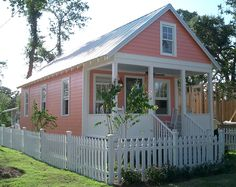 Little pink cottage with picket fence