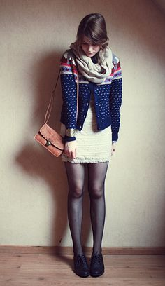 Ivory lace dress, patterned cable knit cardigan, black tights & shoes, coral shoulder bag, taupe scarf.