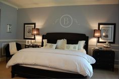 Gray Timber Wolf- Behr. Wall monogram is stupid. But I like the chair rail and detail on bottom half of walls.