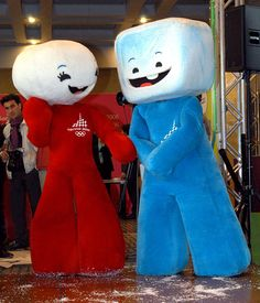 The 2006 Turin Winter Olympic mascots Neve, at left, and Glitz perform during their presentation in Rome, Tuesday, Sept. 28, 2004. The Olympic mascots, representing a ball of snow and a block of ice, are designed by Portuguese designer Pedro Albuquerque. (AP Photo/Marianna Bertagnolli)