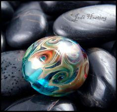 One of my handmade glass lampwork beads. You can check out  my creations at www.beadworx.com