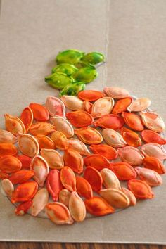 pumpkin seed art-- this is pretty neat. Perhaps, we'll try this in my room this year. :)