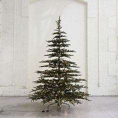christmas tree lights Check out Pre-Lit LED Faux Noble Fir from Terrain Noble Fir Christmas Tree, Best Artificial Christmas Trees, Scandinavian Christmas Trees, Types Of Christmas Trees, White Christmas Trees, Christmas Tree Design, Victorian Christmas, Alpine Christmas Tree, Christmas Ideas