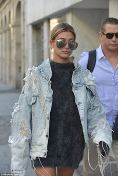Grungy chic: The blonde beauty rocked a thigh-skimming dress which she gave a tough edge t...