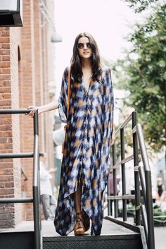 """""""Oh, excuse me. Let me just rock my fashion muumuu. Look out, I'm cozy and the best dressed gal in the city."""""""