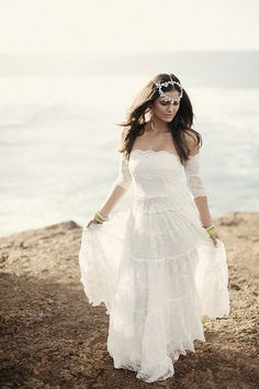 Bohemian strapless wedding dress featuring stunning arm bands and amazing lace panelled skirt via Etsy