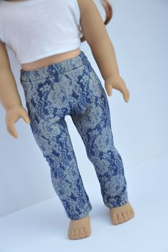 Denim floral print jeggings by CircleCSewing on Etsy. Made using the LJC Leggings pattern. Find it at http://www.pixiefaire.com/products/leggings-18-doll-clothes. #pixiefaire #libertyjane #leggings