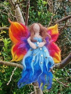this little unique fairy comes gift boxed and scented she is about 6 inches tall .... she is made from 11 colours and has been carefully made using needle felt and a little bit of love and magic ...£12 + postage...