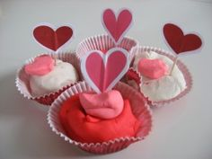 Valentines playdough Cupcakes- use cookie cutters and let them practice cutting hearts (adult draw first) and cutting them out and gluing on toothpick- a lot of skills are used here in a fun way