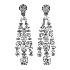Art Deco platinum and diamond ear pendants | From a unique collection of vintage chandelier earrings at http://www.1stdibs.com/jewelry/earrings/chandelier-earrings/