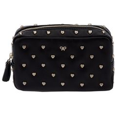 Black leather cosmetic case from Anya Hindmarch featuring all-over gold-tone hear studs with embossed signature bow and a gold-tone zip across the top with ton…