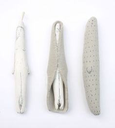 sandy mcinnes - selkie amulets:  bone sealskin leather wool