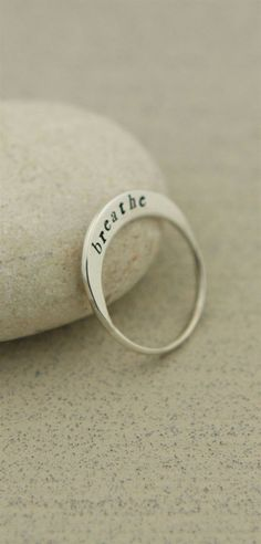 """A lovely little crescent sits atop your finger when your wear this sleek oblong ring of sterling silver. Engraved with the word, """"Breathe,"""" it will bring you to a place of relaxation and centeredness…MoreMore #SilverJewelry"""