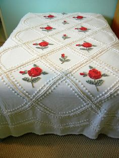 Vintage chenille bedspread, white with red roses.