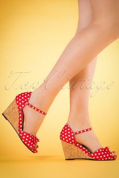 These60s Molly Polkadot Wedgesare truly amazing wedges!  Love... just pure love! One look at these beauties and you're sold! Made from a red fabric with white polkadots, dark blue trims with pindots and a playful bow. You're feet are hurting? Not while wearing these babies! Thanks to the cork wedges and a super comfy padded footbed you'll never want to take them off again. Love is... finding the perfect shoe? ;-)   Wedge heel Adjustable ankle strap Si...