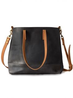 The Abera Crossbody Tote can be worn over the shoulder, or across your body, and is the ideal size to function as your work bag or as your everyday purse. The black leather body + cognac strap accents are the perfect duo to take you from day to night. It features an interior pocket and a magnetic closure.