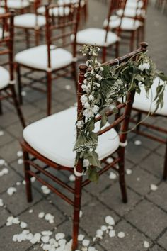 In love with the floral design on these aisle chairs | Image by Melissa Marshall