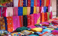 For some local colour and shopping the Sunday market at Centre de Flacq, where textiles and foods etc. are modestly priced is well worth a visit.    This is one of the many colourful textile stalls