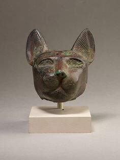 Head from statue of a cat Period: Late Period Date: 664–332 B.C. Geography: Country of Origin Egypt Medium: Copper alloy