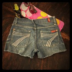 7 For All Mankind Cut Off Shorts Super cute cut off Dojo shorts. In great condition. Dojo style runs a little small on me so they are in need of a loving home. Offers welcome 7 Shorts Jean Shorts