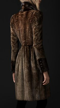 Survive the cold with this printed mink fur coat from Burberry.     Its structured shoulder and nipped-in waist make it a form fitted design.