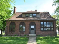 This brick beauty has 2911 finished sq ft and a 1373 sq ft unfinished basement 4 bedrooms with a 5th optional 1.5 bath 2 car garage enclosed porch drive-thru driveway on a corner lot.  Much of the home features original hardwood floors.  Inside youll also find two living spaces a bonus room dining room off of the kicthen breakfast nook naturally lit office and original wood burning fireplace.  Updates include newer roof some newer windows and a HE boiler.