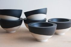 White ceramic bowl with black mat glaze.Great for serving appetizers and desserts. Urban and modern look.