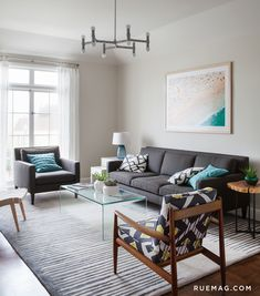 Living room with Benjamin Moore Edgecomb Gray walls, gray sofa, geometric modern chair, turquoise accents