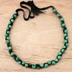 Green Beaded Leather Necklace with Acai Seed |#handmade #chunky #eco See more here: http://www.artisansintheandes.com/beaded-necklaces-bib-necklace-chunky/beaded-necklaces-green-leather-chunky