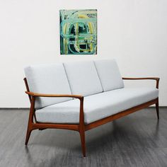 Beautifully curved Knoll Antimott three seat sofa from the 1960s, solid teakwood. Nice, not-too-soft upholstery with new light grey cover. Good general condition with small traces of usage. There are two armchairs available separatedly.