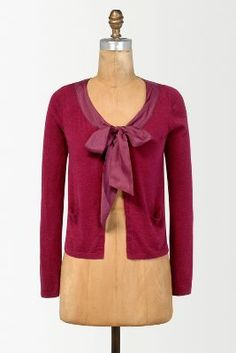 I love this Anthropologie cardigan but can't afford the price tag.  However I have a few basic cardigans like this in my wardrobe already - so?  I am thinking of heading to a haberdashery shop, buying some toning wide ribbon and with a little sewing, maybe I will own my own version of this cardigan?  It can't hurt to try.