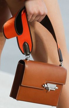 Hermes Spring Summer 2019 Runway Bag Collection The Hermes Spring Summer 2019 Runway offers a peek on the collection of next year. And there is a particular handbag that we really adore. It's curved and - Hermes Spring Summer 2019 Runway Bag Collection Hermes Bags, Hermes Handbags, Leather Handbags, Balenciaga Handbags, Cheap Handbags, Handbags Online, Leather Bags, Luxury Handbags, Summer Bags