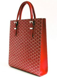 An interesting bag shape for a career woman to put documents and a lap top in. Goyard.