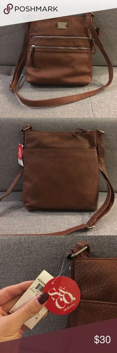 Brand New Style & Co Veronica Crossbody Purse Style & Co Veronica Crossbody purse with front zip pockets and adjustable straps. Brand new with tags and in a whiskey color. Perfect everyday purse! Style & Co Bags Crossbody Bags
