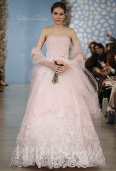 "Brides.com: 34 Colorful Wedding Dresses That Prove You Don't Have to Wear White. ""Aline"" pink tulle ball gown with ivory silk organza flower applique and lace embroidery and a pink tulle wrap, Oscar de la Renta  See wedding dresses from Oscar de la Renta's most recent bridal runway show."