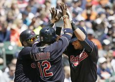 Cleveland Indians' Yan Gomes, right, is congratulated by teammates Mike Napoli, left, and Francisco Lindor (12) after Gomes' three-run home run during the third inning of Saturday's game against the Detroit Tigers. indians won 10-1 (Carlos Osorio, AP)