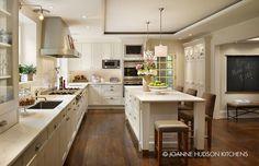 Clean white kitchen with dark hardwood floors. Joanne Hudson Design