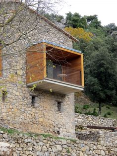 "Built by Arcadi Pla Masmiquel,Núria Pla Illa in Montagut, Spain with surface Images by Aleix Bagué. The project consisted of the restoration of the house ""El Bosquet"", which is inside the neighbourhood of ""Can Gustí"",. Grange Restaurant, Facade Design, House Design, Stone Facade, Brick And Stone, Stone Houses, Facade House, Architecture Details, Interior And Exterior"