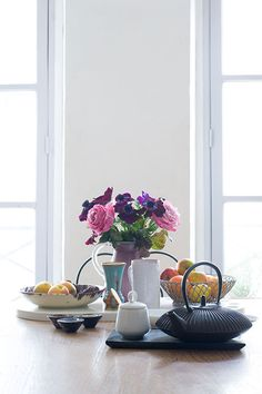 """Sneak Peek: Isabelle Rivoire-Grange. """"This is a very small — yet growing — collection of antique ceramic vases and little ashtrays. The cast iron teapot is from Japan."""" #sneakpeek"""