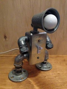 "Golf Clubs Repurposed Robot lamp toggle switch by JosephBarral on Etsy - Handmade ""industrial robot"" lamp design with functioning switch. This lamp is hand made in my Brooklyn studio. (and is awesome) Metal Projects, Welding Projects, Diy Projects, Welding Crafts, Project Ideas, Pipe Furniture, Industrial Furniture, Industrial Lamps, Vintage Industrial"