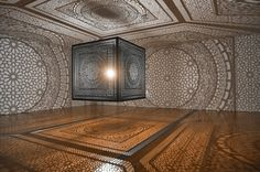 Winner of both the public and juried vote of Artprize 2014, Pakistani artist Anila Quayyum Agha exercises the architecture of the Grand Rapids Art Museum in Michigan by infilling it with a dynamic interplay of shadow and light. Intersections comprises a 6.5 foot laser-cut wooden cube pierced with carefully crafted patterns and illuminated from the inside, which casts expansive, lace-like geometries onto the surrounding walls, ceiling and floor.
