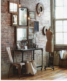 Indoor brick, vintage decor, different sized mirrors and frames. This is my home decor wish all in one photo.