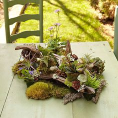 Combine foraged finds with a few garden center purchases in this natural display for the patio or an indoor table.  See this project and more great ideas in the summer issue of Country Gardens Magazine, on newsstands through